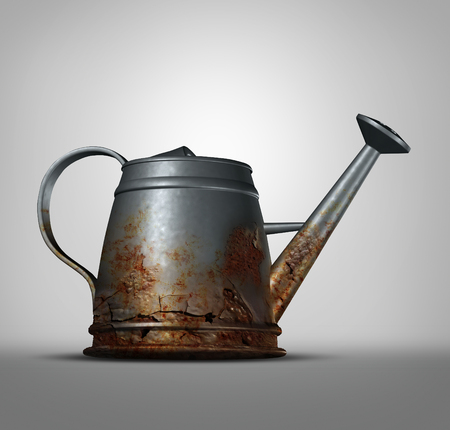 corroded: Water problem as a watering can that is corroded and decaying with with rust due to neglected weathering and oxidation as a conservation and health metaphor for clean drinking liquid free from lead and poison. Stock Photo