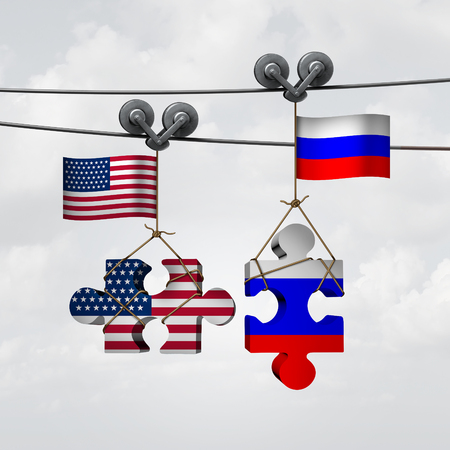 unite: American and Russian cooperation success as two pieces of a jigsaw puzzle fron the United States and Russia coming together to unite as a global teamwork metaphor for an international agreement.