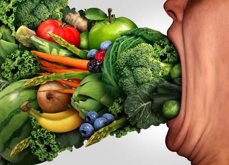 to eat: Eat healthy nutrition concept as a person with a wide open stretched mouth eating fresh fruits and vegetables as a health and fitness lifestyle symbol. Stock Photo