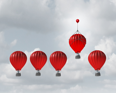 standout: Competitive edge and business advantage concept as a group of hot air balloons racing to the top but an individualleader with a small balloon attached giving the winning competitor an extra boost to win the competition.