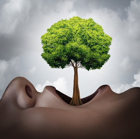 verb: Growing your vocabulary concept and speech therapy symbol as a human open mouth with a tree growing as a tongue as a metaphor for language grammar and voice growth. Stock Photo