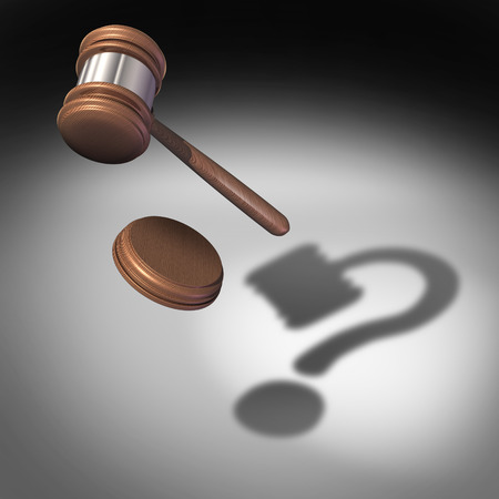 Law question concept and court questions symbol and legal advice icon as a judge gavel or mallet with a sound block falling casting a shadow shaped as a question mark representing uncertainty in legality issues.