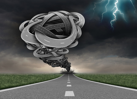 Tornado road concept as a group of twisted tangled streets shaped as a funnel twister destroying a path as a business metaphor for powerful forces of destruction. Stock Photo