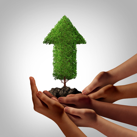 Diversity community working together for success concept as a group of multiethnic people hands full of soil holding up an arrow tree as a global cooperation and team empowerment metaphor. Stock Photo