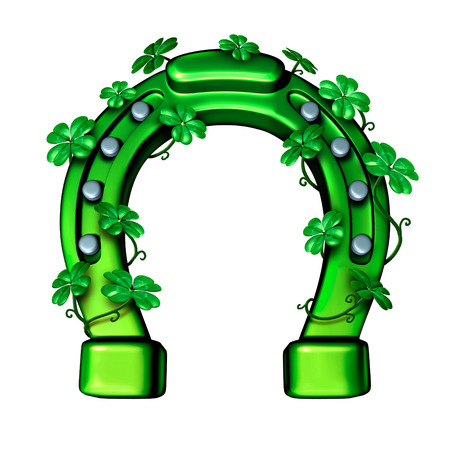 lucky clover: Green horseshoe as a lucky fortune symbol for saint patricks day or luck of the Irish icon wrapped with shamrock four leaf clover leaves. Stock Photo
