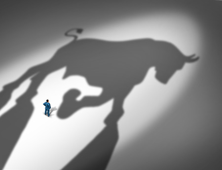 bull market: Stock market growth indicator and financial business trend concept as the cast shadow of a bull looming over a businessman as a profit and positive forecast signal for future investment success.