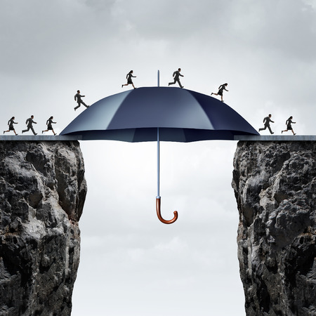 Security bridge concept as business people running across two high cliffs with the help of a safe giant umbrella bridging the gap.