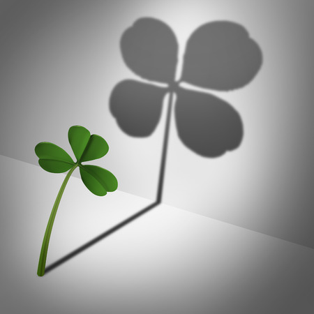 Think positive as an optimistic motvational concept and feeling lucky and positive thinking and inner confidence icon as a three leaf clover casting a shadow with four leaves as a metaphor for optimism and believing in success.
