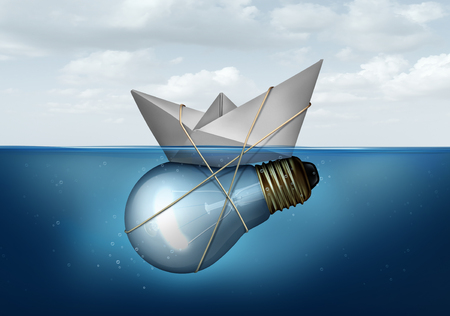 business symbols: Business innovative solution and creative concept as a paper boat tied to a light bulb or lightbulb object as a success metaphor for smart corporate thinking solving economic and transportation challenges. Stock Photo