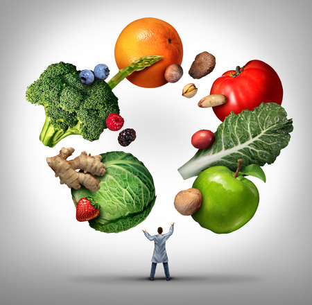 nutrition: Nutritionist doctor or dietician and dietitian professional health food concept as a medical physician juggling fruits vegetables and nuts as a nutritionist professional advice symbol.