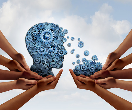 acquiring: Group training and skill development business education concept with many diverse hands holding a bunch of gears transferring the wheels to a human head made of cogs as a symbol of acquiring the tools for team learning.