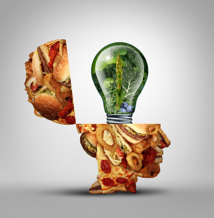 greasy: Diet ideas and dieting inspiration concept as an open human head made of greasy junk food with a lightbulb idea icon made of green fruits and vegetables as a nutrition and health care metaphor. Stock Photo