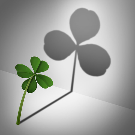 three leaf clover: Low self esteem psychological concept as a four leaf clover casting a shadow with only three leaves as a mental health condition of feeling inadequate or negative thinking and low self confidence. Stock Photo