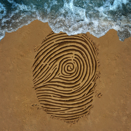 security symbol: Identity crisis concept as a finger print pattern on beach sand with an ocean wave washing away the information as a security symbol for encryption or anonymity ID protection or fading away icon.