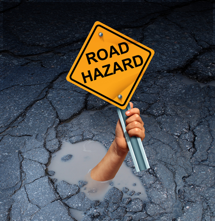 pot hole: Road hazard concept as an accident victim drowning in a broken street pothole while holding a traffic sign as a transportation maintenance failure and public works disrepair risk. Stock Photo