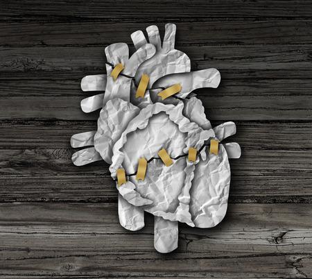 Human hartoperatie medische concept of cardiologie symbool als een cardiale operatie therapie en cardiovasculaire chirurgische ingreep als een gebroken orgaan gemaakt van proppen papier gerepareerd met tape.