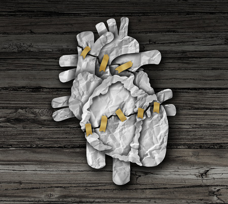 medical treatment: Human heart surgery medical concept or cardiology symbol as a cardiac operation therapy treatment and cardiovascular surgical procedure as a broken organ made of crumpled paper repaired with tape. Stock Photo