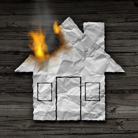House fire concept and residential smoke disaster and burning destruction symbol as crumpled paper shaped as a family home residence as a 3D illustration on rustic wood.