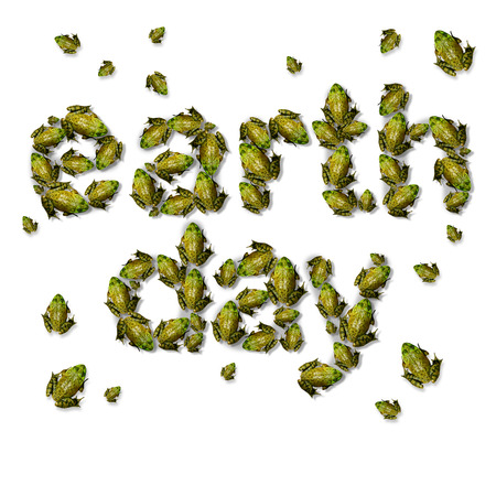 coming together: Green earth day ecxological concept as a group of frogs coming together to form text as an environmental symbol for protection of endagered habitat. Stock Photo
