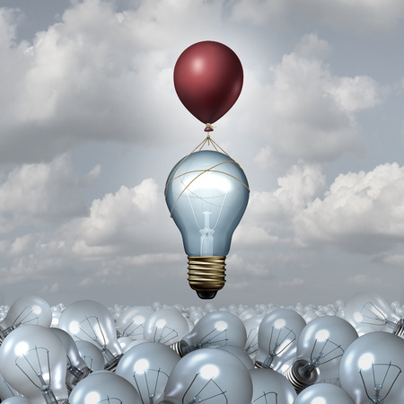 Innovative thinking concept as a group of 3D illustration light bulbs in a vast landscape as one lightbulb rises up with the help of a balloon as a motivation metaphor for creative innovation inspiration. Stock Photo