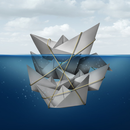 Living off others concept and corner the market symbol as a dominant paper boat dominating a group of smaller boats tied together helping the leader float above water as a metaphor for leadership. Stock Photo