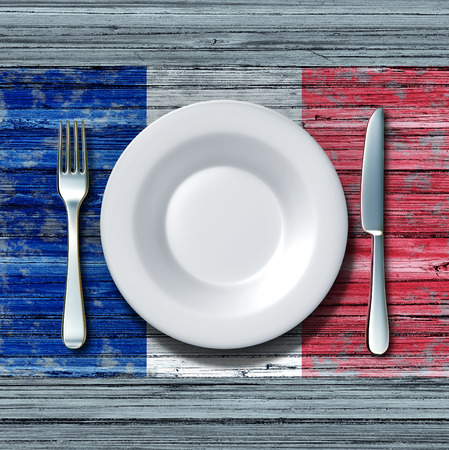 french culture: French cuisine food concept as a place setting with knife and fork on an old rustic wood table with a symbol of the flag of France as an icon of traditional mediterranean family eating in Paris with 3D illustration elements. Stock Photo