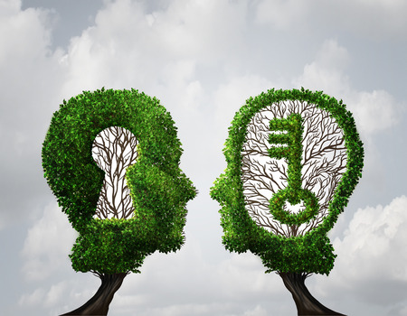Key hole Solution partnership and key opportunity business concept as two trees shaped as a human head with a key and keyhole shapes as a collaboration success metaphor in a 3D illustration style. 写真素材