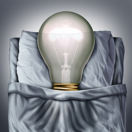 business metaphor: Sleep ideas and sleeping concept as a 3D illustration light bulb resting in bed on a pillow as a business metaphor for creative rest or sleeping solutions.