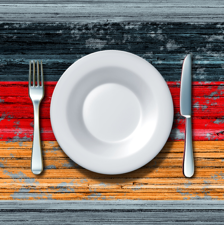 german food: German cuisine food concept as a place setting with knife and fork on an old rustic wood table with an icon flag of Germany as an icon of traditional eating in Berlin with 3D illustration elements.