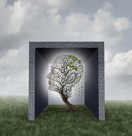 human head: Emotional walls psychological concept as a tree shaped as a human head losing leaves inside a brick wall box as a feelings metaphor and social isolation symbol with 3D illustration elements. Stock Photo