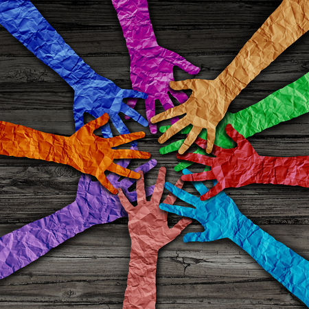 Diverse people team joining hands together as a partnership teamwork concept as a group of paper cut out hands as a diversity collaboration symbol in a 3D illustration style. Фото со стока