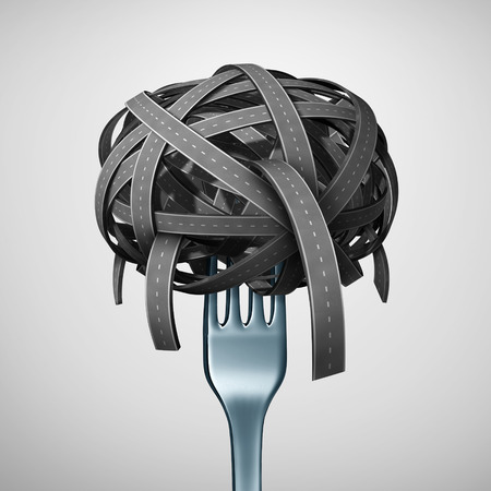 Food Transport or eating on the road concept as a fork inside a pile of twisted streets and highways shaped as pasta or spaghetti as a transportation symbol for shipping or delivering a meal as a 3D illustration. Stock Photo