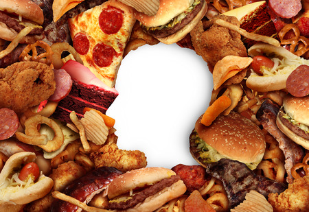 Eating fatty food and unhealthy diet health concept with a group of greasy fast food in the shape of a human head symbol of dangerous nutrition lifestyle and icon of addiction to risky snacks in a 3D illustration style. Stockfoto