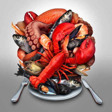 Seafood plate concept as a group of shellfish crustacean and fish grouped together on a dinner place setting as a fresh delicious meal from the ocean as lobster steamed clams mussels shrimp octopus and sardines. Imagens