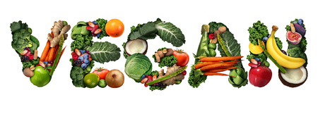 vegan: Vegan concept and veganism lifestyle icon as a group of fruit vegetables nuts and beans shaped as text isolated on a white background as a healthy diet symbol for eating green biological natural food. Stock Photo
