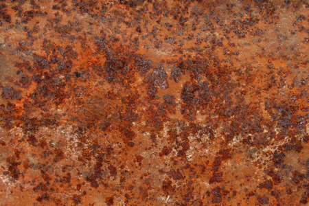 corrode: rust background as an abstract texture representing decay and weathering as an oxidized iron element.