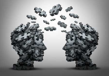 Solution exchange and tranfer of ideas concept as a group of jigsaw puzzle pieces shaped as two human heads exchanging answers to challenges as a business problem solving motivation metaphor as a 3D illustration.