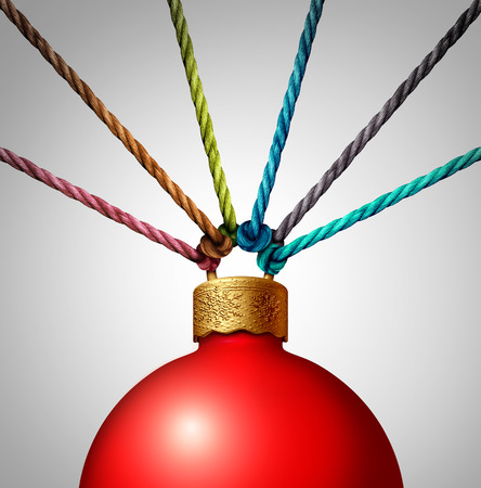 Together for christmas charity concept helping and providing volunteer support as a group of ropes holding a winter holiday ornament as a festive symbol for charitable community diversity help with 3D illustration elements.