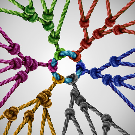 coming together: Team groups network as individual diverse teams coming together connected to a central point as an abstract communication concept with linked ropes of different colors as a metaphore for social connection.