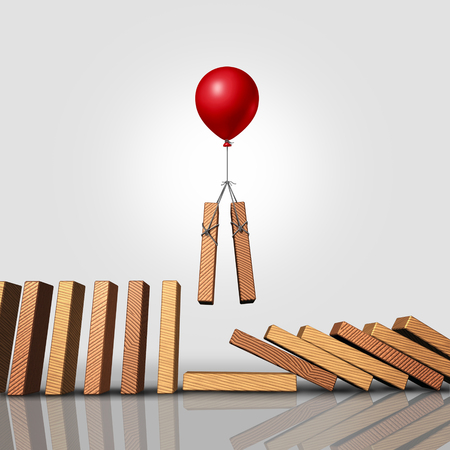 Downsizing business strategy as a balloon lifting up a pair of domino pieces allowing the gap to stop the falling dominoes as a corporate management symbol and human resources plan for long term success as a 3D illustration.