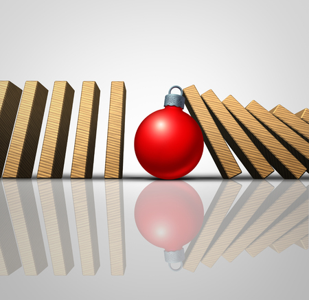 Christmas help and winter holiday support concept as falling domino pieces stopped by a supportive seasonal tree ornament as a volunteering metaphor for charity and philanthropy as a 3D illustration. Stock Photo