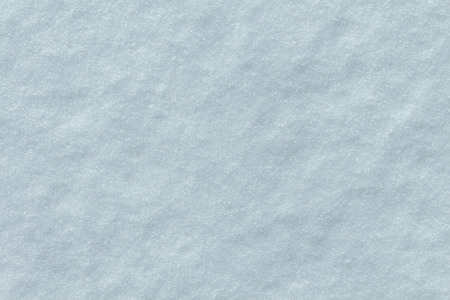 Snow texture background as a cold surface made of white winter snowflakes. Stock Photo