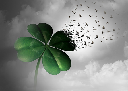 Losing luck or spreading good fortune concept as a four leaf clover transforming into flying birds as a surreal communication metaphor for financial and life success or decay loss and failure  with 3D illustration elements. Stock Photo