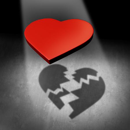 Broken love concept and valentine relationship breakup or couple separation and divorce metaphor as a red heart casting a shadow in broken pieces as a 3D illustration.