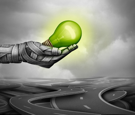 Green driving concept as a hand made of roads holding a glowing light bulb as an electric energy transport fuel economy technology symbol as a 3D illustration. Stock Photo