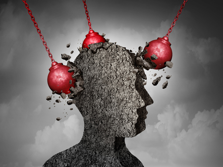 Painful Headache pain and pounding migraine concept as a human head made of cement being destroyed or renovated by a group of wrecking ball objects as a symbol for personal change as a 3D illustration. 免版税图像