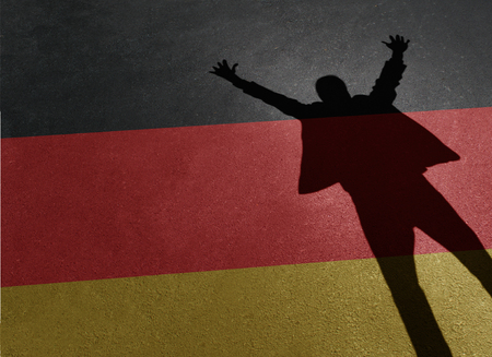 flag: Germany success concept as the shadow of a person on colors of a flag celebrating a victory or German business opportunity in a 3D illustration style. Stock Photo