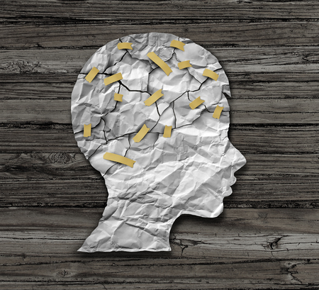 concussion: Child psychology and psychiatric therapy for children concept as broken crumpled paper taped together as an education support and medical or counselling treatment metaphor in a 3D illustration style. Stock Photo
