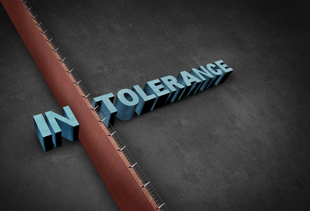 Intolerance and intolerant concept as a border wall dividing a word representing prejudice and discrimination as a 3D illustration. Stock Photo