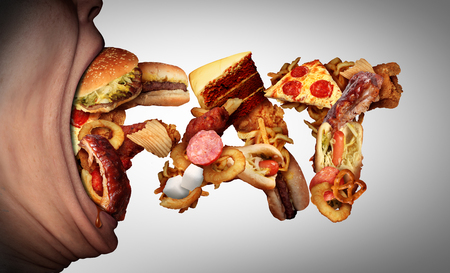 junk: Eating fat food concept as an open mouth biting into unhealthy snacks shaped as text as a bad nutrition and obesity symbol for craving high calorie fatty meals.